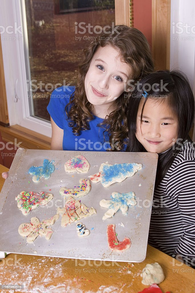 Sisters showing off Christmas cookies royalty-free stock photo