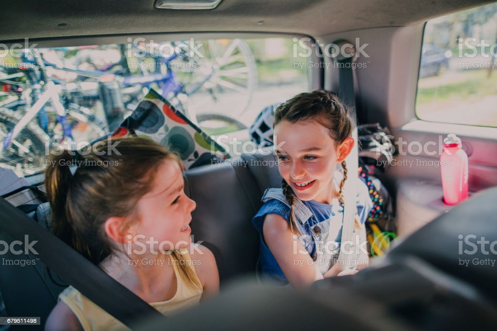 Sisters Sitting in Their Family Car stock photo