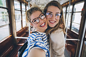 istock Sisters taking selfie in vintage tram 683034896