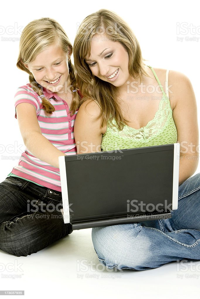 Sisters with laptop isolated on white royalty-free stock photo