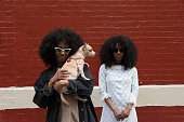 Sisters with their dog on the street in Soho, Manhattan, NY