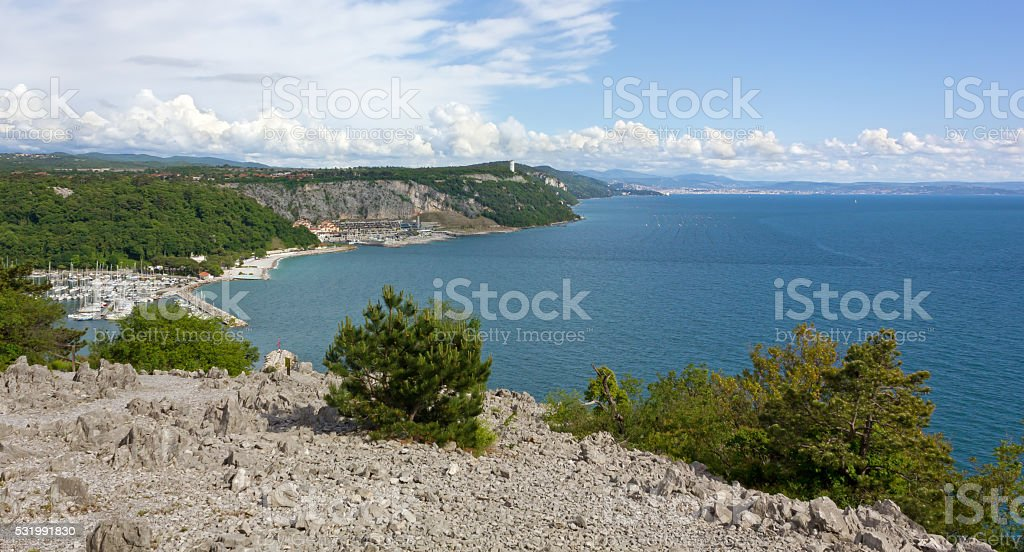Sistiana Bay Marina and Coastline toward Trieste stock photo