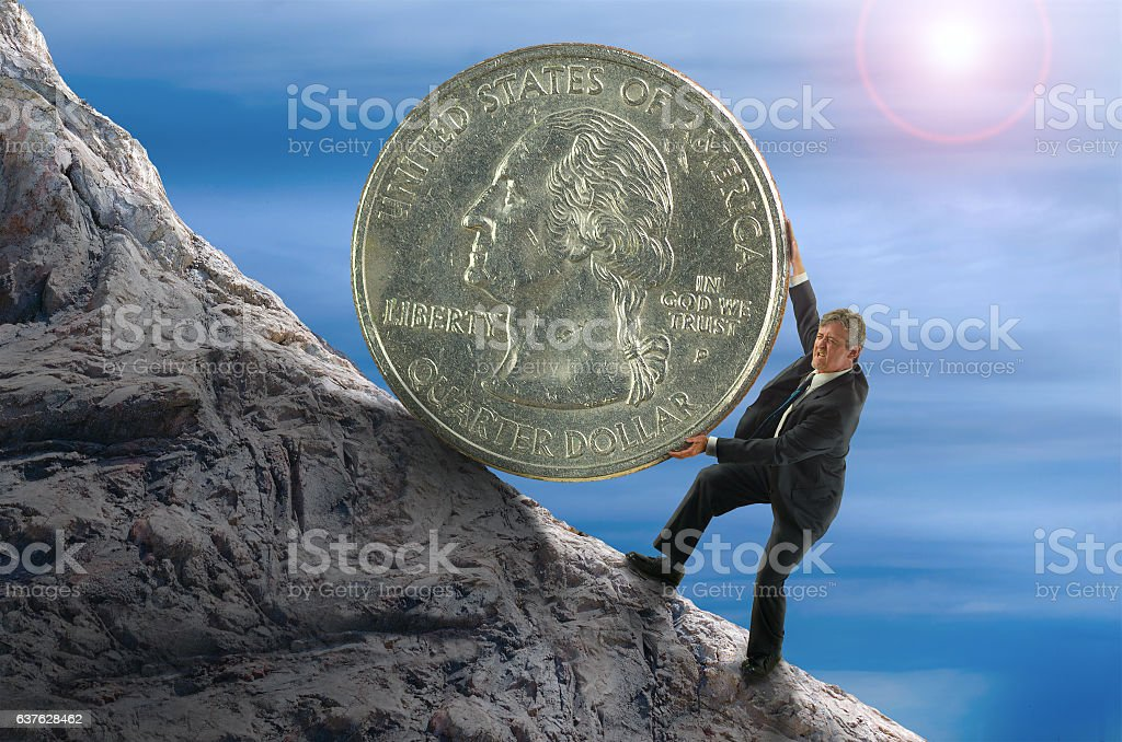 Sisyphus financial concept man rolling huge coin up hill stock photo