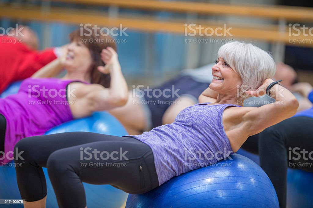 Sit Ups on Exercise Balls at the Gym stock photo
