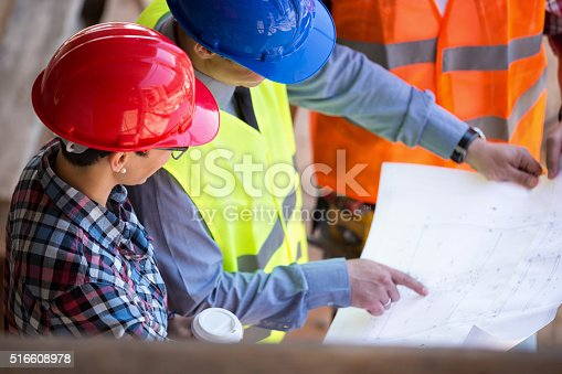 516607254 istock photo site manager  looking blueprint with architects 516608978