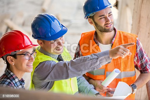 516607254istockphoto Site manager pointing on place of future building 516598000