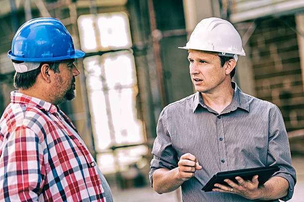 Site manager with construction foreman stock photo