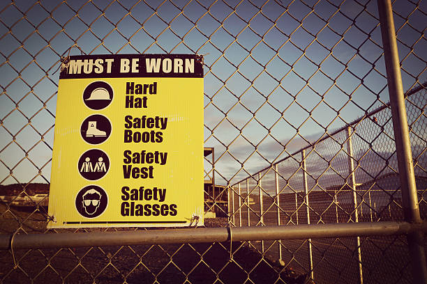 Site safety signs construction site for health and safety stock photo