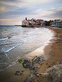 Sitges at sunset from San Sebastia beach. Spain