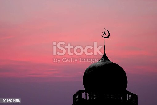 sithouette of masjid dome (mosque) on red sky background