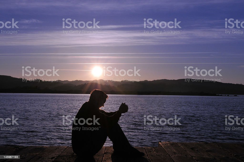 Sitting and Praying royalty-free stock photo