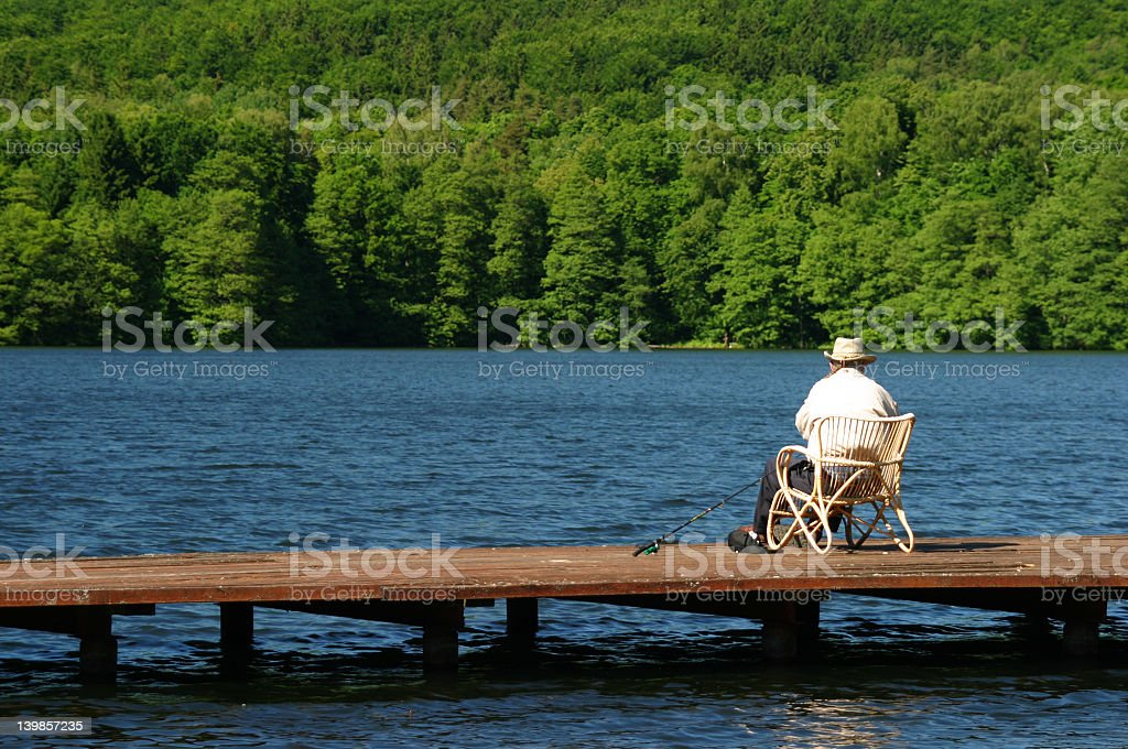 Sitting angler at the lake royalty-free stock photo