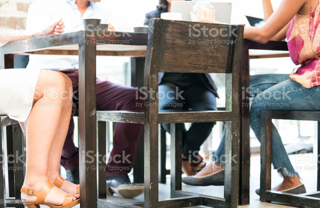 Sitting around cafe table - defocused. stock photo