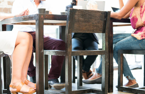Sitting around cafe table - defocused. stock photo