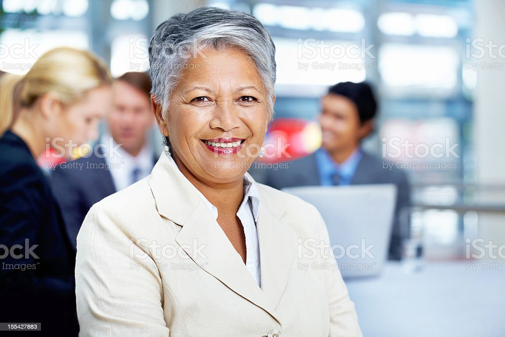 Sitting at the top of our corporate ladder royalty-free stock photo