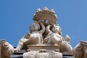 istock Sitting baroque putto statues of Dresden Zwinger 1290877468