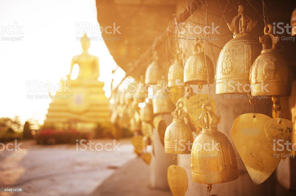Sitting Buddha and buddhist bells stock photo