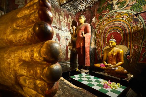 Sitting Buddha, statue in Dambulla cave temple. UNESCO Golden Temple of Dambulla, beautiful sacred place in Sri Lanka. Very popular tourist place. stock photo