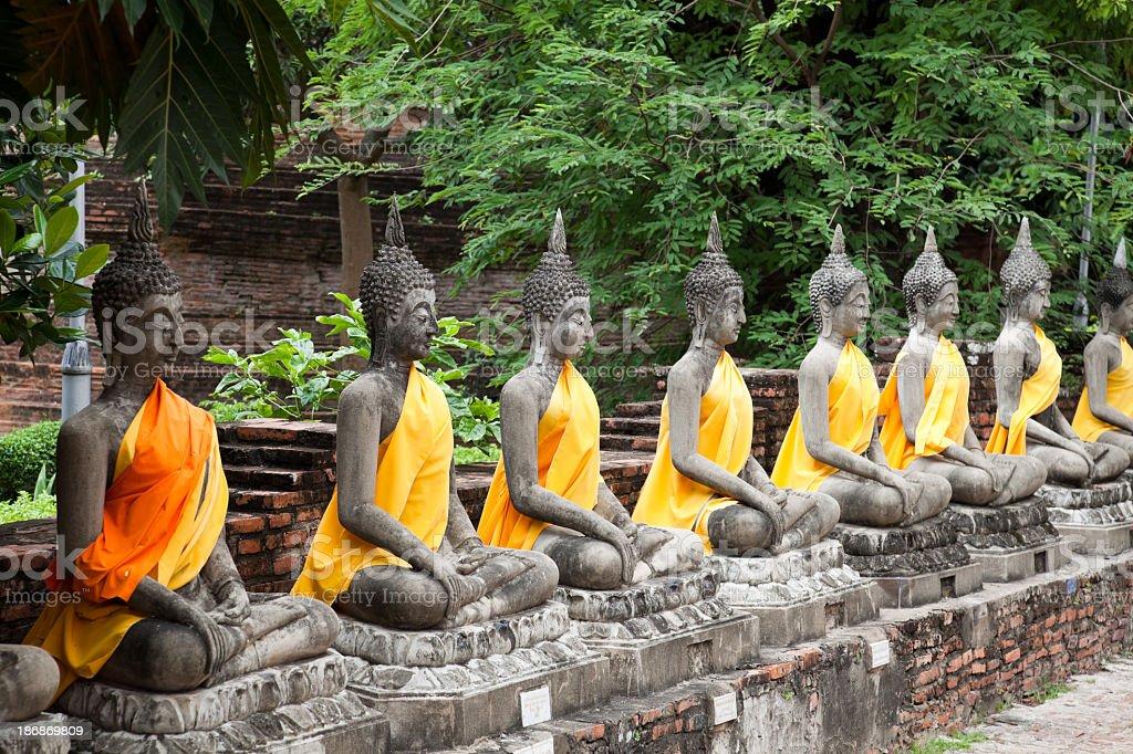 Sitting Buddhas images at Wat Yai Chai Mongkol, Ayutthaya, Thailand stock photo