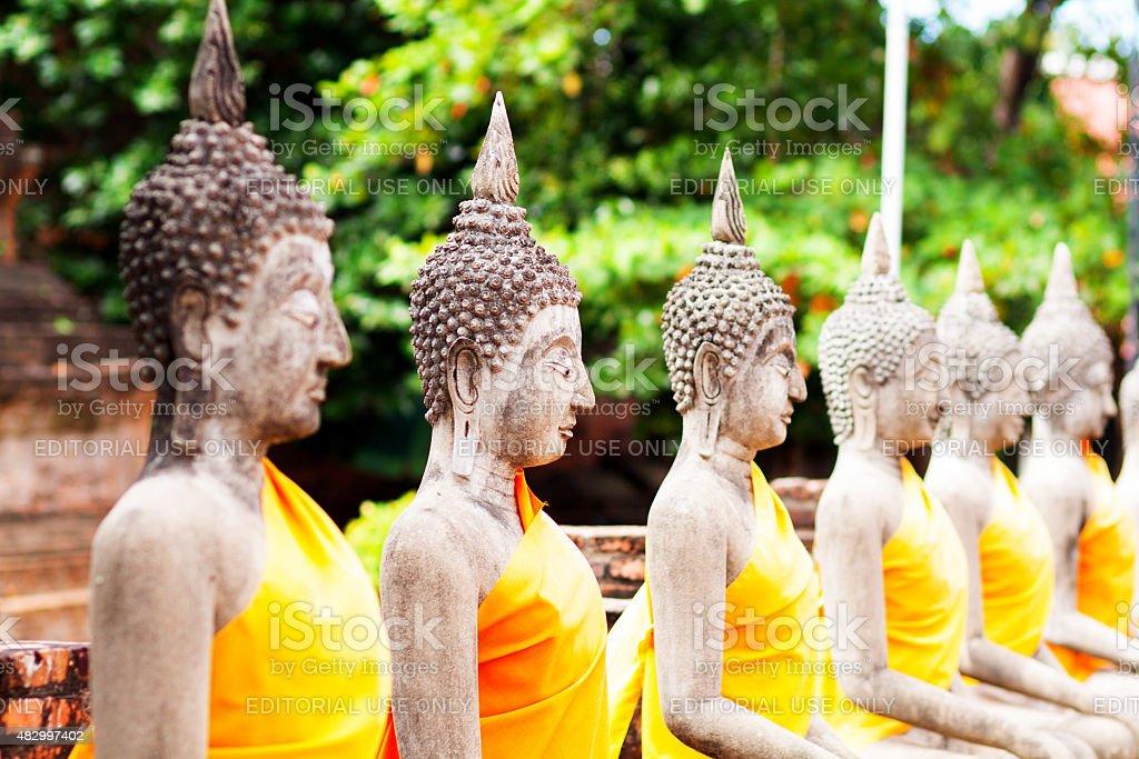 Sitting buddhas on wall stock photo