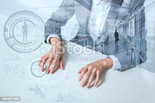 istock sitting business woman and graphical user interface, smart office, smart desk, futuristic GUI(Graphical User Interface), IoT(Internet of Things), technological abstract 684807980