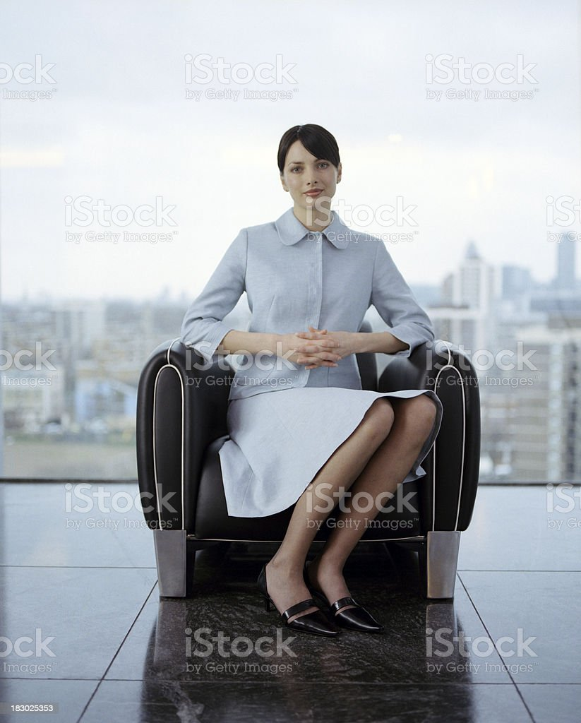 Sitting Businesswoman in contemporary office royalty-free stock photo