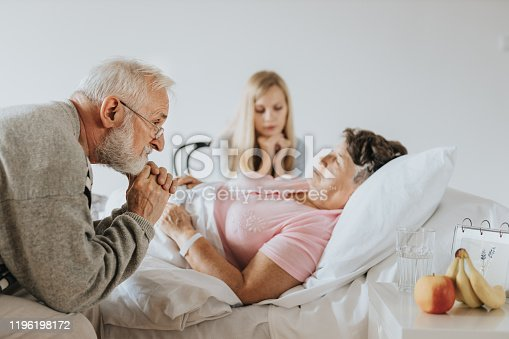 829742744 istock photo Sitting by bed 1196198172