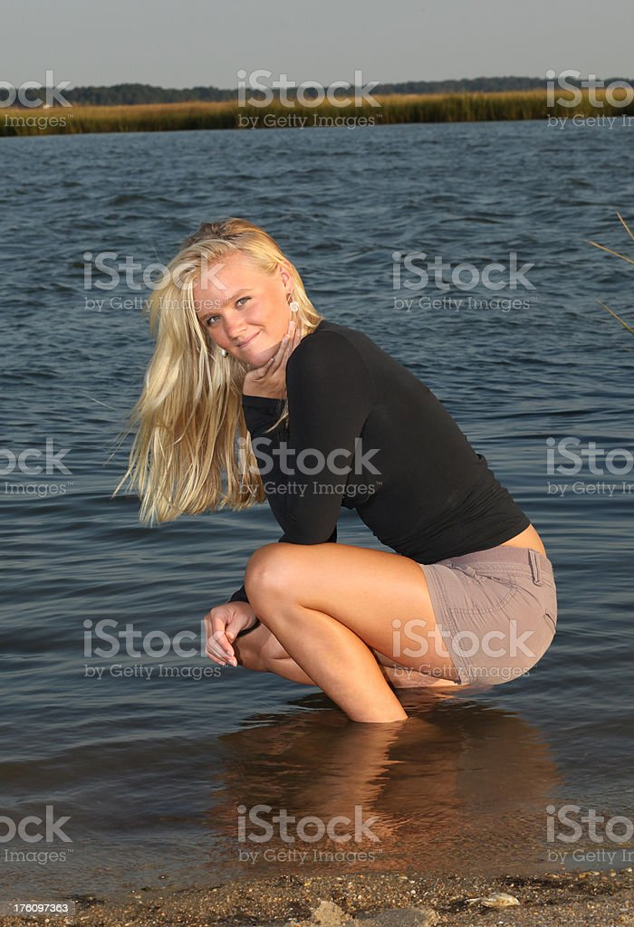 Sitting by the bay. stock photo