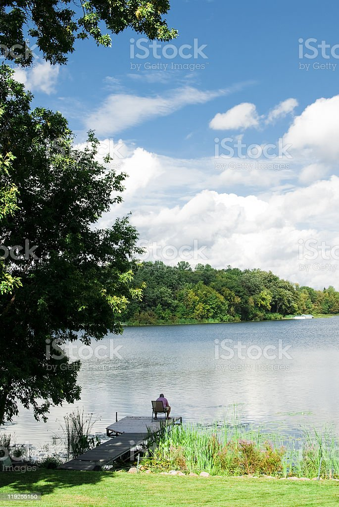 sitting by the lake royalty-free stock photo
