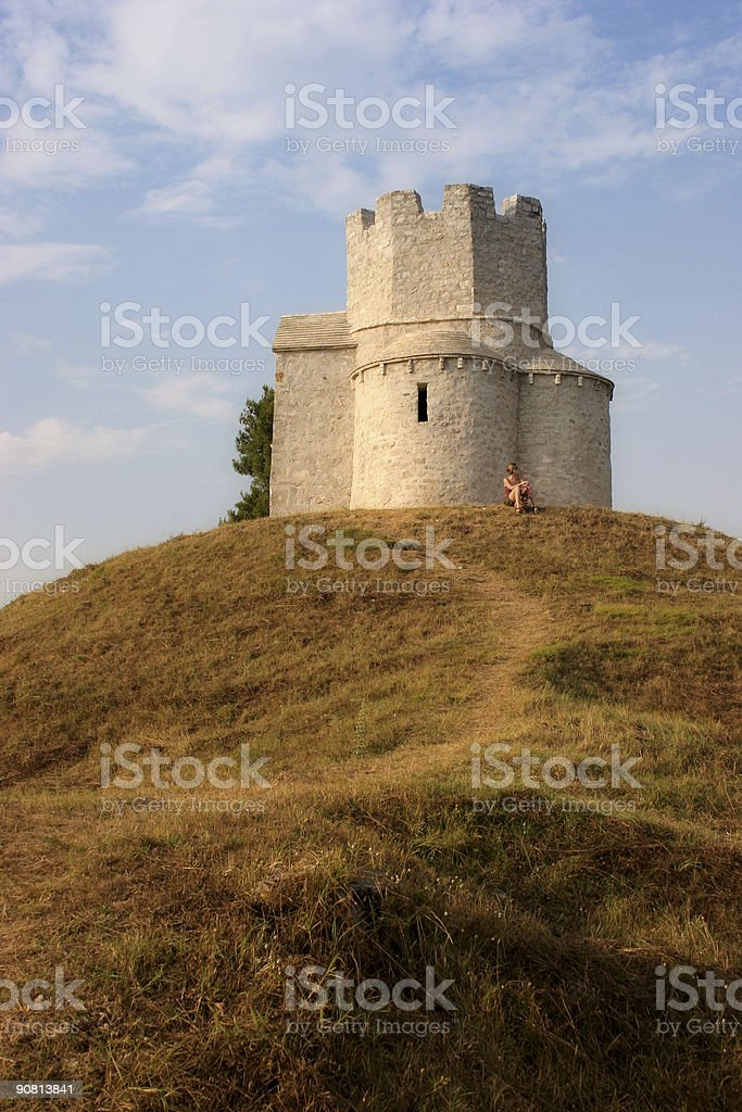 sitting by the old church royalty-free stock photo