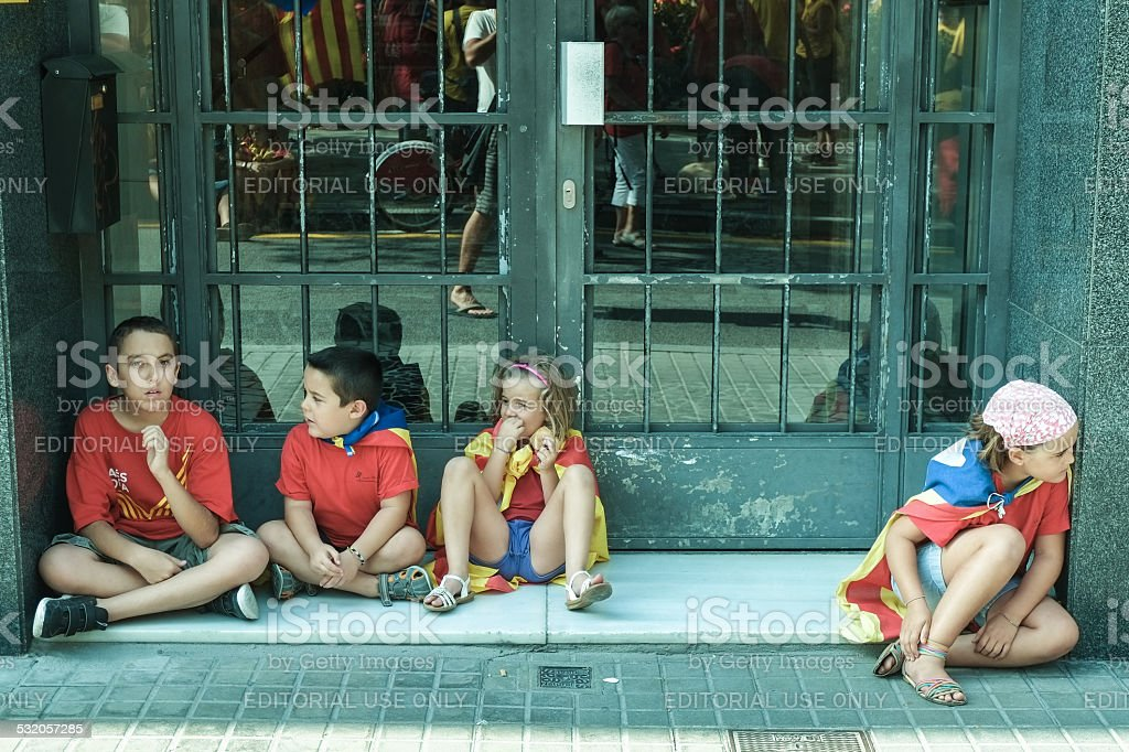 Sitting children at National Day of Catalonia in Barcelona stock photo