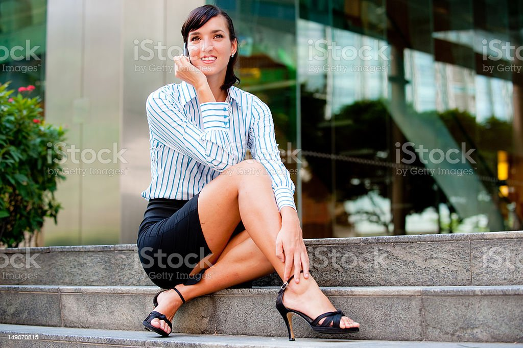 Sitting down on the phone royalty-free stock photo