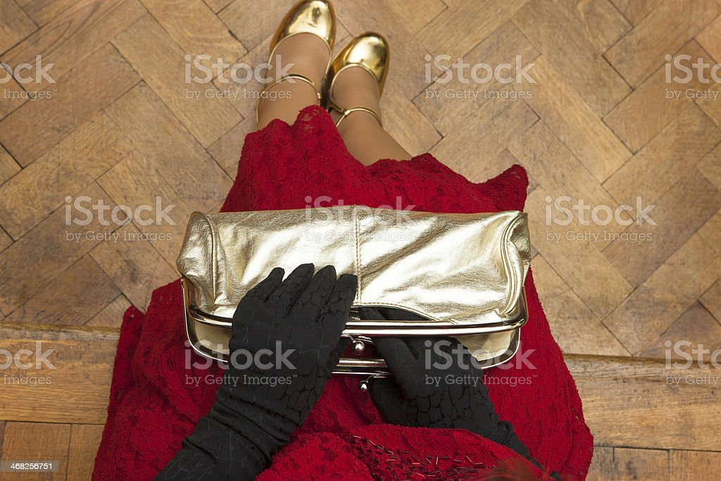 Sitting girl in red dress stock photo