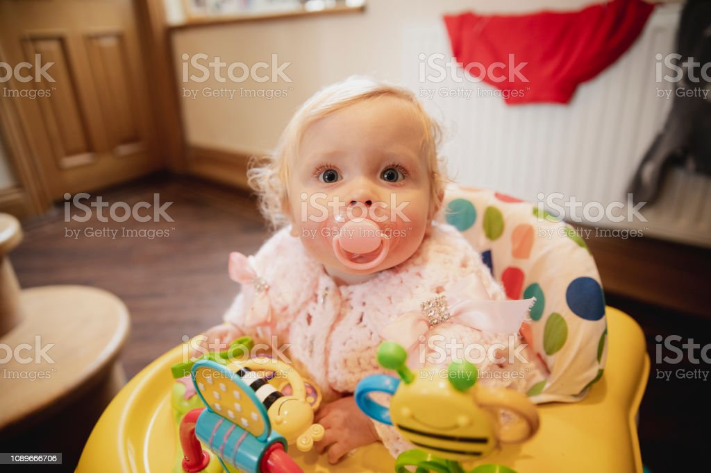 Sitting in a Baby Walker stock photo