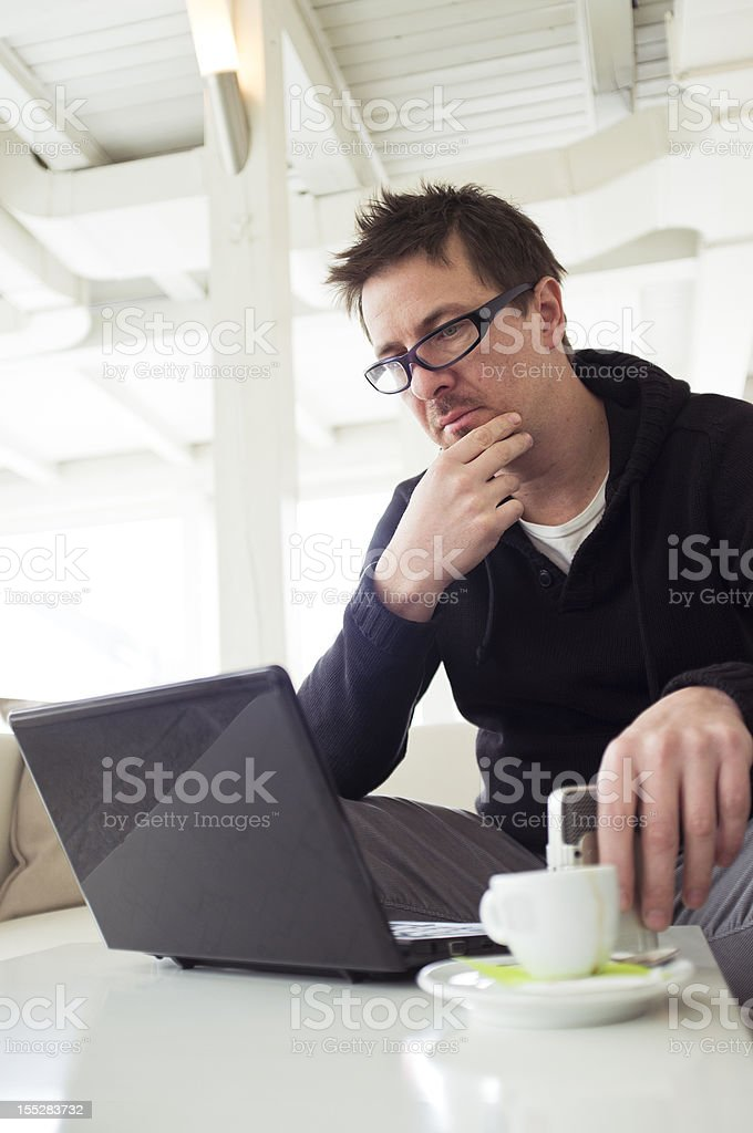 Sitting in cafe surfing the net royalty-free stock photo