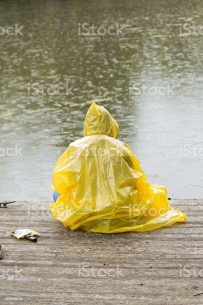 Sitting in the rain stock photo