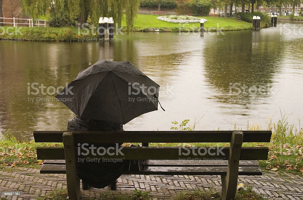 Sitting in the rain royalty-free stock photo