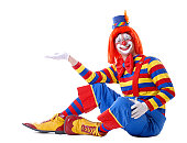 istock Sitting Male Clown Holding Out His Hand 139898747