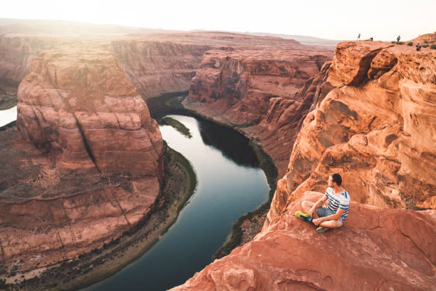 Sitting near the Horseshoe bend Horseshoe bend in Arizona horseshoe bend colorado river stock pictures, royalty-free photos & images