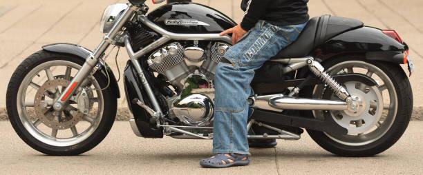 Sitting on a Harley Davidson stock photo