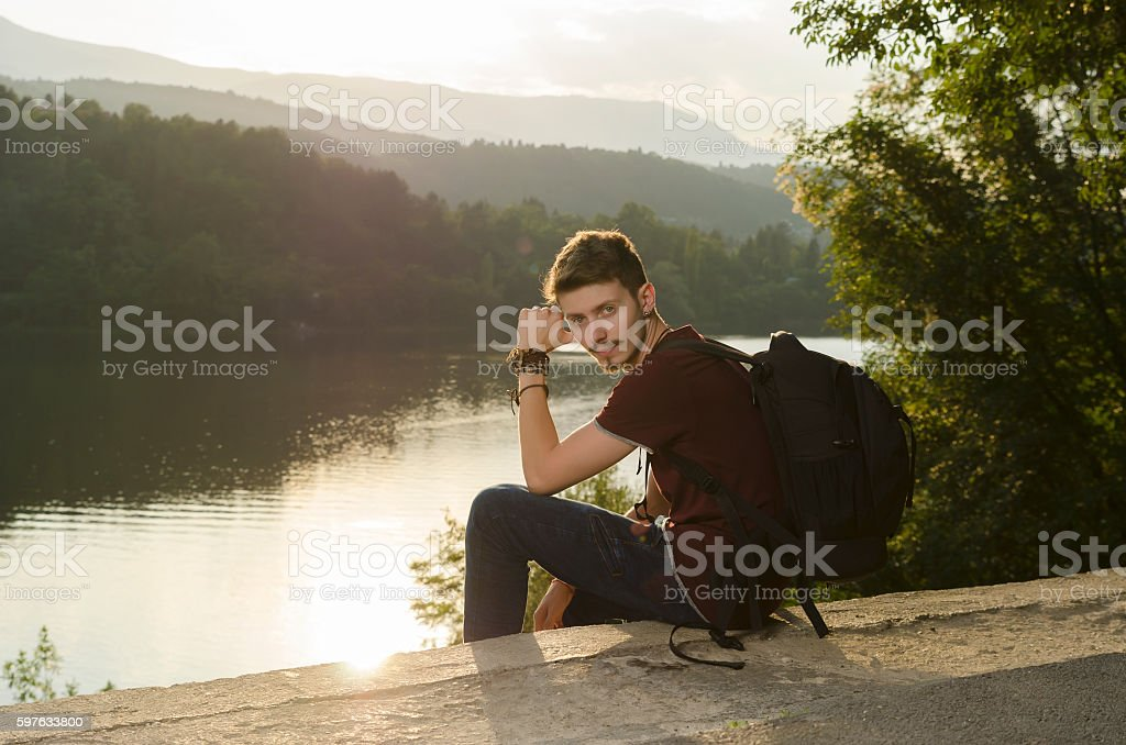Sitting on a lake shore and relaxing stock photo