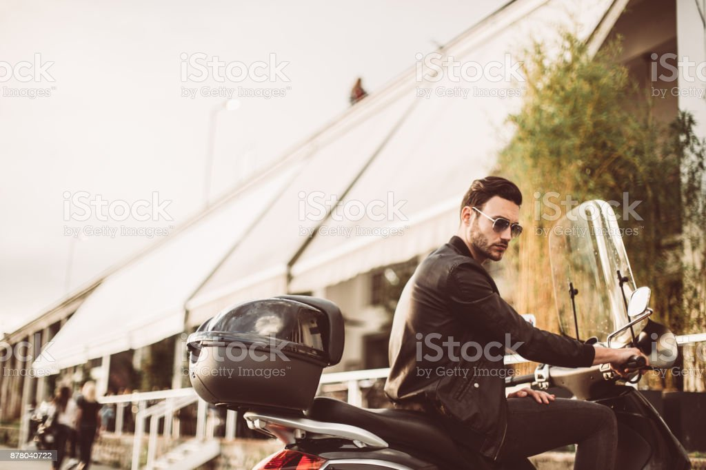 Sitting on a motorcycle stock photo