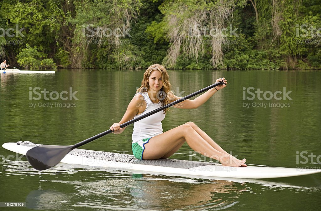 Sitting on a Stand Up Paddle Board royalty-free stock photo