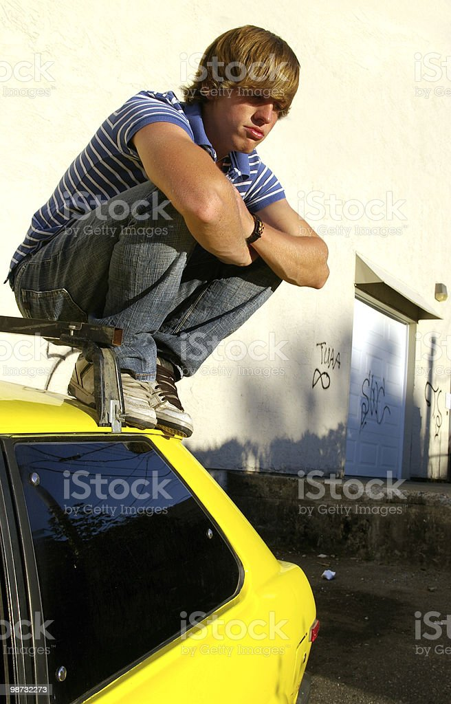 Sitting on Car royalty free stockfoto