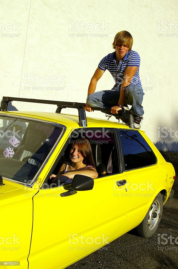 Sitting on Car Roof royalty-free stock photo