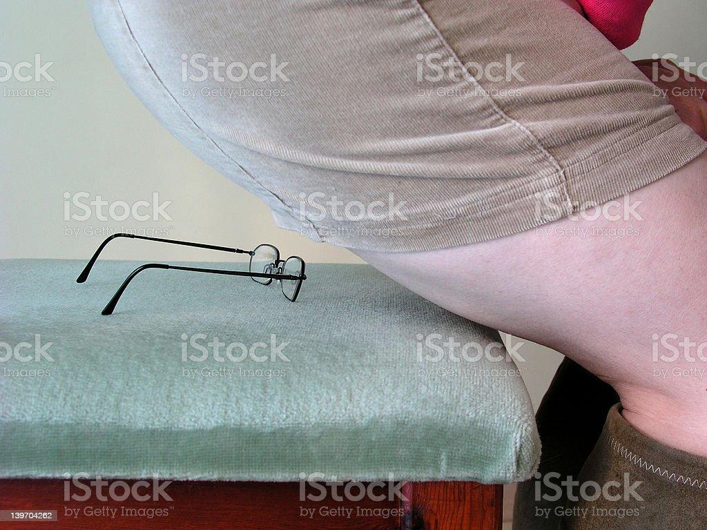 Sitting on glasses stock photo