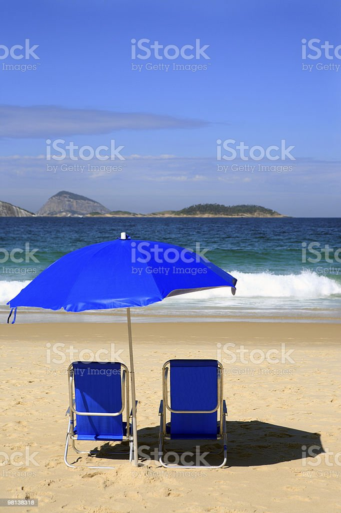 sitting on ipanema two blue deck chair n the beach royalty-free stock photo
