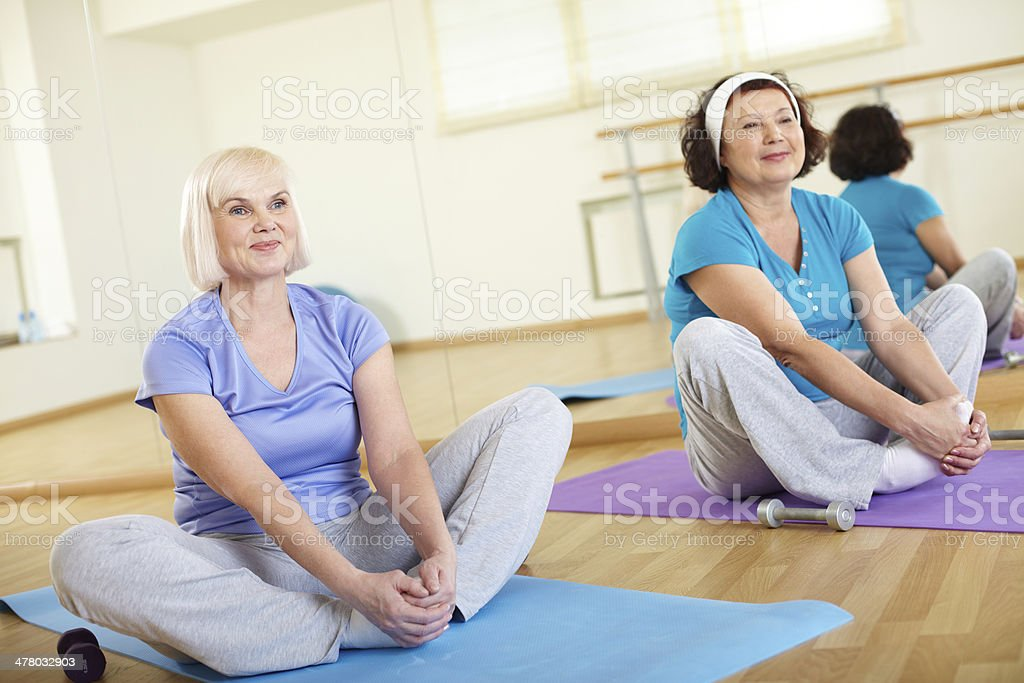 Sitting on mats royalty-free stock photo
