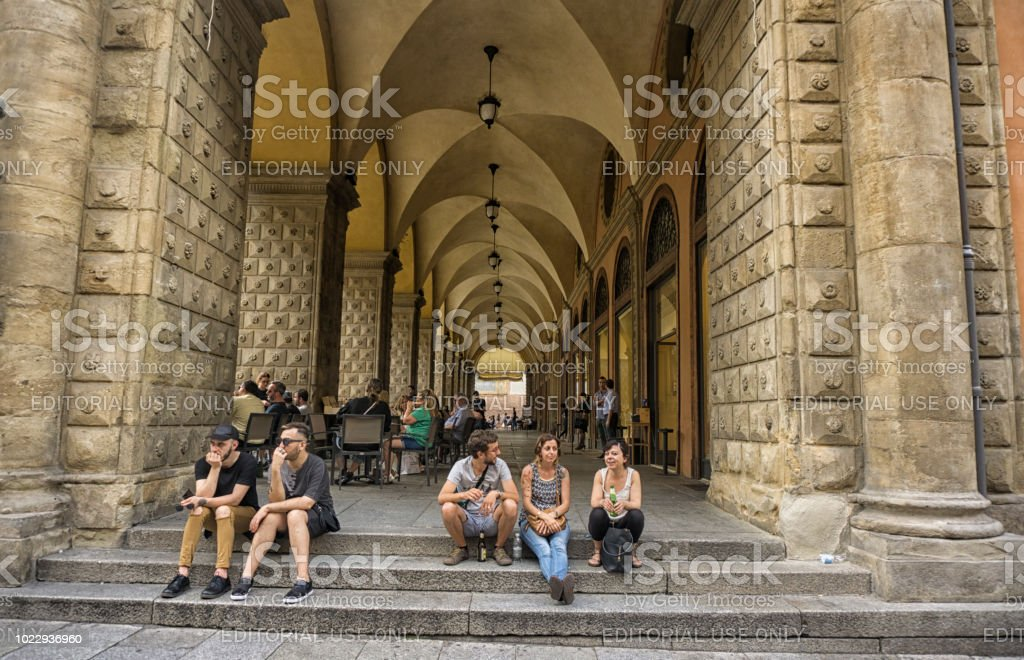 Sitting on the arcade steps stock photo