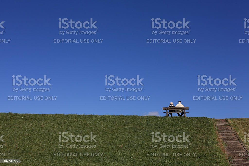 sitting on top of a dike stock photo